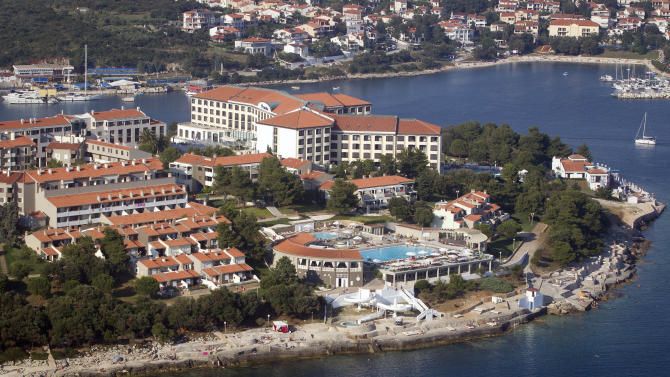In this photo taken June 17, 2013, a tourist resort in Pula, northern Adriatic is seen from the air. On Monday July 1, 2013, Croatia will become the 28th EU member, the bloc's first addition since Bulgaria and Romania joined in 2007. Croatia's membership marks a historic turning point for the small country, which went through carnage after declaring independence from the former Yugoslavia in 1991. (AP Photo/Darko Bandic)