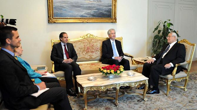 This image released by the office of the Egyptian Presidency shows U.S. Deputy Secretary of State William Burns, center, meeting with Egypt's interim President Adly Mansour, right, as U.S. ambassador to Egypt Anne Patterson listens in, second left, at the presidential palace in Cairo, Monday, July 15, 2013. The senior U.S. diplomat held talks Monday with Egypt's interim leaders as well as the head of the military in the highest level visit by an American official since the Egyptian army ousted the country's first democratically elected leader. The two-day visit by Burns to Cairo comes nearly two weeks after Islamist President Mohammed Morsi was overthrown by the military following days of mass protests. Washington has been sharply criticized by both Morsi's supporters and opponents for what each side perceives as support for their rival's position. (AP Photo/Egyptian Presidency)