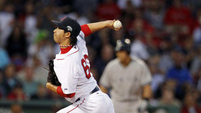 Boston Red Sox's Junichi Tazawa pitches in the eighth inning of a baseball game against the New York Yankees in Boston, Saturday, April 21, 2012. (AP Photo/Michael Dwyer)