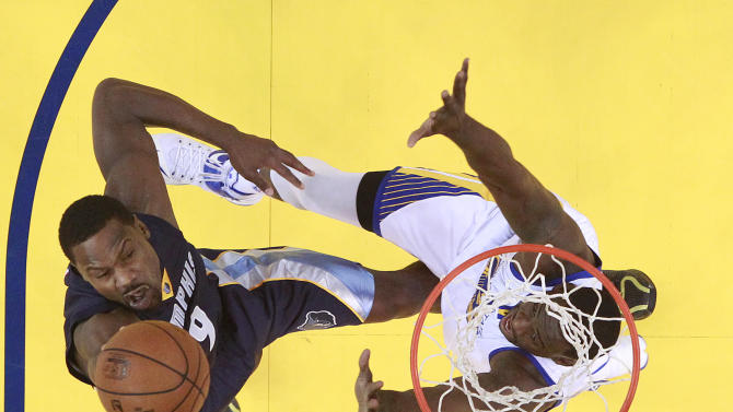 Memphis Grizzlies forward Tony Allen, left, shoots against Golden State Warriors forward Draymond Green during the first half of Game 1 in a second-round NBA playoff basketball series in Oakland, Calif., Sunday, May 3, 2015. (AP Photo/Marcio Jose Sanchez)