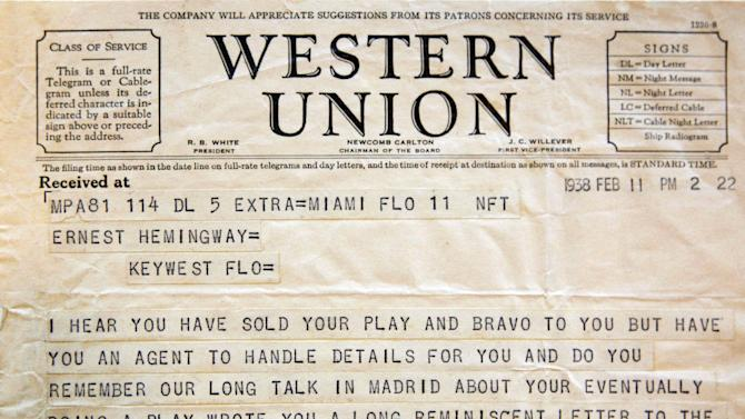 This Sept. 11, 2012, photo shows a telegram sent to Ernest Hemingway from American theater producer Jean Dalrymple in 1938, a part of the Hemingway collection at the John F. Kennedy Library and Museum in Boston, which is being sent out for restoration. Among letters written to Ernest Hemingway slated for repair are dispatches from public figures including Hollywood stars Ingrid Bergman and Marlene Dietrich, writers F. Scott Fitzgerald and Gertrude Stein, and Hemingway's editor Max Perkins. (AP Photo/Stephan Savoia)