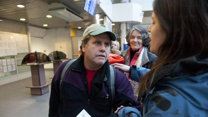 In this photo released by Greenpeace, Greenpeace International activist Captain Peter Willcox of the U.S. leaves for the departure lounge at St. Petersburg airport, in St. Petersburg, Russia, Friday, Dec. 27, 2013. Greenpeace activists released from custody following an amnesty over their protest in the Russian Arctic say they have no regrets. (AP Photo/Greenpeace International/ Dmitri Sharomov)