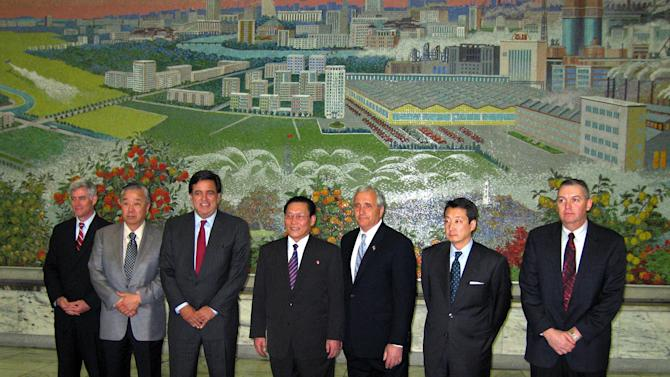 FILE - In this April 10, 2007 file photo, New Mexico Gov. Bill Richardson, third left, and Anthony Principi, former U.S. veterans affairs secretary, third right, and top White House adviser on Korea, Victor Cha, second right, pose for a photo with Kim Yong Dae, vice-president of the Presidium of the DPRK Supreme People's Assembly, center, in Pyongyang, North Korea. Google's executive chairman Eric Schmidt will be traveling to North Korea on a private trip led by former New Mexico Gov. Bill Richardson that could take place as early as this month, sources told The Associated Press on Wednesday, Jan. 2, 2013. The sources, two people familiar with the group's plans, asked not to be named because the visit had not been made public. (AP Photo/Foster Klug, File)