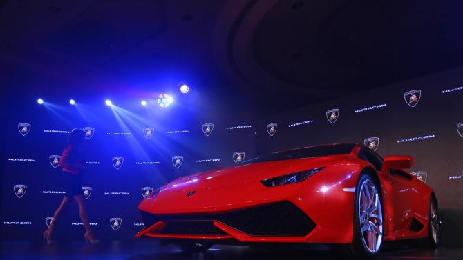 A host walks past the Huracan LP 610-4 during its launch ceremony in Mumbai