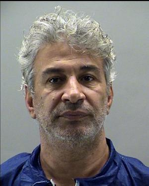 In this Sunday, July 27, 2014, photo provided by the Montgomery County Sheriff's Office, Metin Atilan, 54, is shown. Atilan, who has been a federal fugitive since 2008, is charged with bribing U.S. military contracting officials for work in Iraq. (AP Photo/Montgomery County Sheriff's Office)