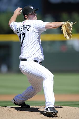 Colorado Rockies rookie starting pitcher Drew Pomeranz, in his Major League debut, throws to the plate against the Cincinnati Reds during the first inning of a baseball game, Sunday, Sept. 11, 20011, in Denver. (AP Photo/Jack Dempsey)