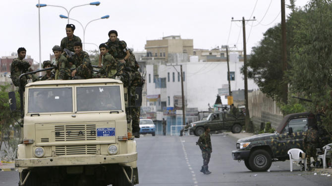 FILE - In this photo Thursday, Sept. 18, 2008 file photo, Yemeni army soldiers patrol the street in front of the US Embassy after the attack by militants with suspected links to al-Qaida against the Embassy in the capital Sana, Yemen. Yemeni warplanes and troops backed by heavy artillery waged a four-front assault on al-Qaida militants Tuesday, trying to uproot their hold in the southern desert with the help of a team of U.S. troops at a nearby air base.(AP Photo/Nasser Nasser, File)
