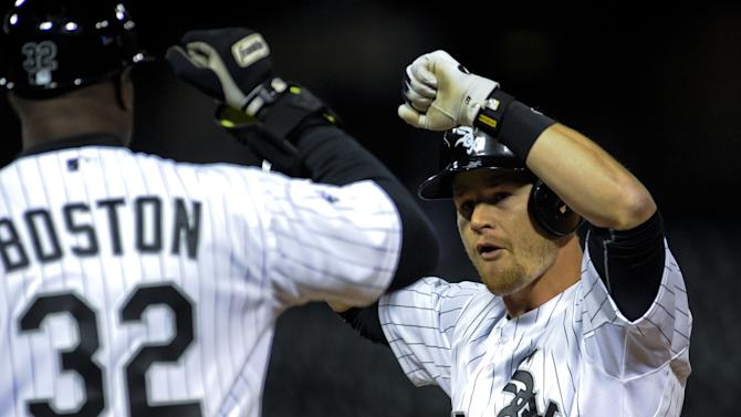 Chicago White Sox second baseman Gordon Beckham celebrates with first base coach Daryl Boston after he hits a single driving Alexi Ramirez home during the ninth inning against the Cleveland Indians during an baseball game on Monday, May 20, 2015, in Chicago. (AP Photo/Matt Marton)