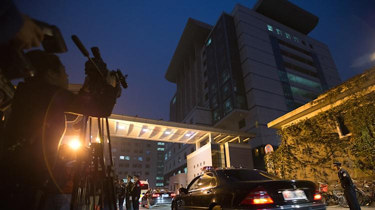 Journalists film a convoy of cars following Norodom Monineath Sihanouk, wife of former Cambodian King Norodom Sihanouk, arrive at a hospital where the king received treatment, in Beijing Monday, Oct. 15, 2012. Sihanouk, the revered former king who was a towering figure in Cambodian politics through a half-century of war, genocide and upheaval, died Monday in Beijing. He was 89. He had been getting medical treatment in China since January and had suffered a variety of illnesses, including colon cancer, diabetes and hypertension. (AP Photo/Andy Wong)
