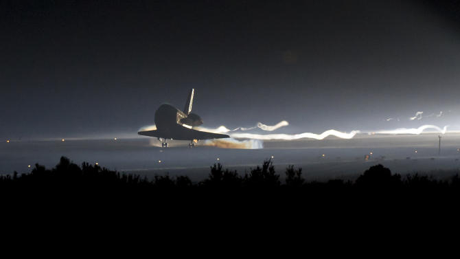 In this image provided by NASA, Space Shuttle Atlantis touches down at NASA's Kennedy Space Center Shuttle Landing Facility in Cape Canaveral, Fla., completing its 13-day mission to the International Space Station and the final flight of the Space Shuttle Program, early Thursday morning, July 21, 2011. Atlantis, the fourth orbiter built, launched on its first mission on Oct. 3, 1985. (AP Photo/NASA - Bill Ingalls)