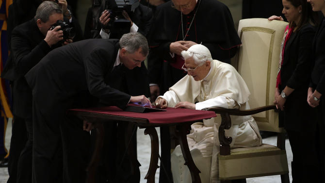 "Pope Benedict XVI pushes a button on a tablet at the Vatican, Wednesday, Dec. 12, 2012. In perhaps the most drawn out Twitter launch ever, Pope Benedict XVI pushed the button on a tablet brought to him at the end of his general audience Wednesday. It read: ""Dear friends, I am pleased to get in touch with you through Twitter. Thank you for your generous response. I bless all of you from my heart.""Later in the day he was to respond to a few messages sent to him from around the world.As the countdown to his first tweet from his Twitter handle (at) Pontifex neared, the pope had garnered nearly 1 million followers in the eight languages of his account. (AP Photo/Gregorio Borgia)"