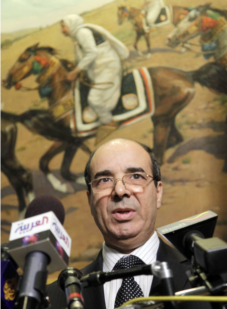 Ibrahim Dabbashi, Libya's deputy United Nations ambassador, discusses the situation in Libya during a news conference, Tuesday, Aug. 23, 2011 in New York. Speaking at Libya's U.N. Mission, with the rebels' red, green and black flag behind him, Dabbashi said,