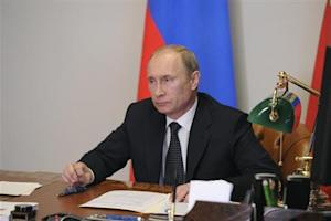 Russian President Putin takes part in a teleconference with Defence Minister Shoigu in Sochi