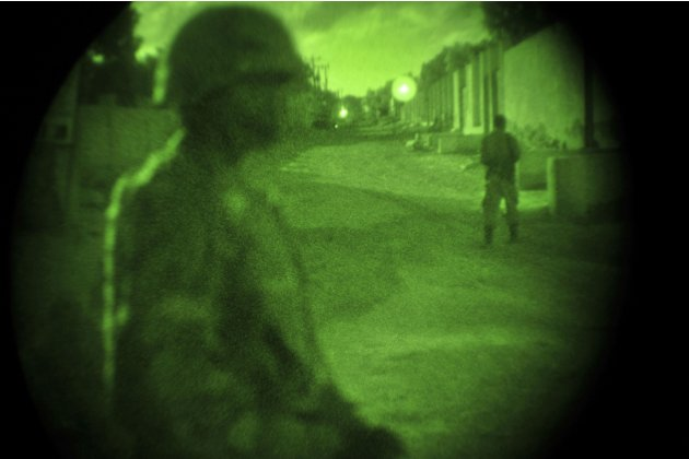 Soldiers are illuminated using a nightvision scope during an operation aimed at improving security in Mogadishu
