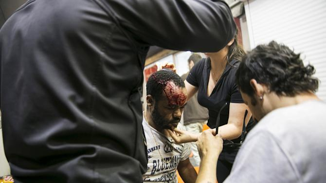 A protester, who is an Israeli Jews of Ethiopian origin, is treated for injury during a demonstration against what they say is police racism and brutality