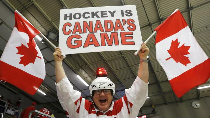 A Canadian fan cheers during play between Canada and the Czech Republic during the first period of their IIHF World Junior Championship ice hockey game in Malmo