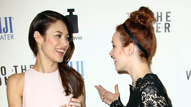 "Actress Rachel McAdams, right, and actress Olga Kurylenko greet each other at the premiere of ""To The Wonder"" hosted by FIJI Water on Tuesday, April 9, 2013 in Los Angeles. (Photo by Matt Sayles/Invision for Fiji Water/AP Images)"
