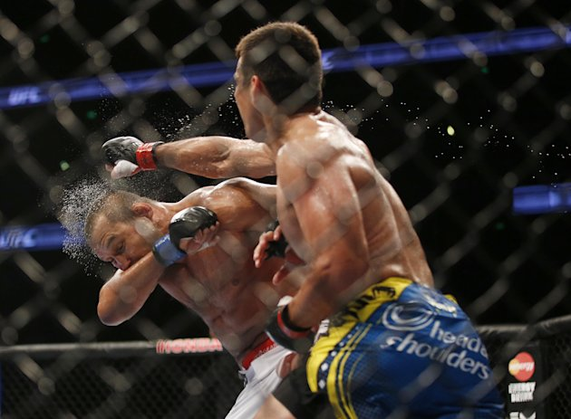 Lyoto Machida, right, of Brazil, lands a punch to the face of  Dan Henderson during their UFC 157 light heavyweight mixed martial arts match in Anaheim, Calif., Saturday, Feb. 23, 2013. Machida won by