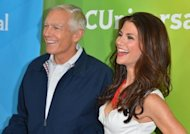 "General Wesley Clark and TV host Samantha Harris are pictured during NBC Universal's 2012 Summer TCA Tour in Los Angeles, in July. An NBC reality show, titled ""Stars Earn Stripes,"" featuring US celebrities competing in quasi-military drills and hosted by Clark, is coming under fire from Nobel laureates and other critics who say the idea trivializes a deadly serious subject"