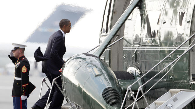 President Barack Obama boards Marine One helicopter Tuesday, Aug. 9, 2011, at Dover Air Force Base, Del., en route to Washington. Obama made an unannounced trip to Dover Air Force Base to pay tribute to the 30 U.S. troops killed over the weekend in Afghanistan. (AP Photo/Carolyn Kaster)