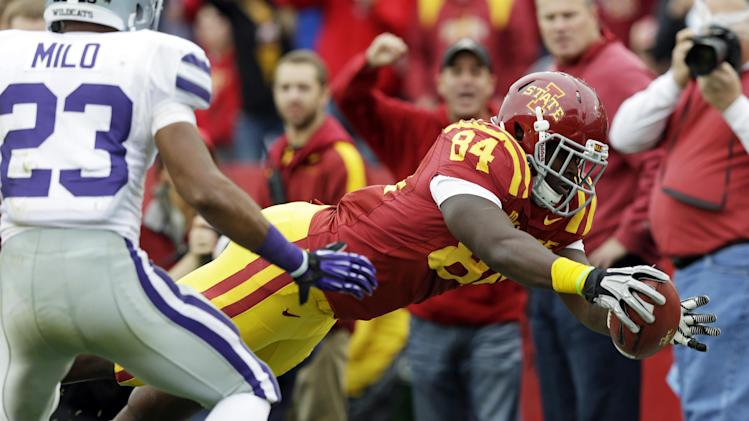 Iowa State tight end Ernst Brun Jr., right, dives to the end zone for a touchdown ahead of Kansas State defensive back Jarard Milo, left, during the first half of an NCAA college football game, Saturday, Oct. 13, 2012, in Ames, Iowa. (AP Photo/Charlie Neibergall)