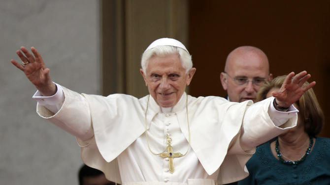 Pope Benedict XVI gestures to journalists after a meeting Cuba's President Raul Castro, not in picture, in Havana, Cuba, Tuesday, March 27, 2012. (AP Photo/Javier Galeano)