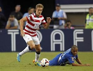 Holden of the U.S. moves the ball away from Honduras' Lopez during their CONCACAF Gold Cup soccer match in Arlington