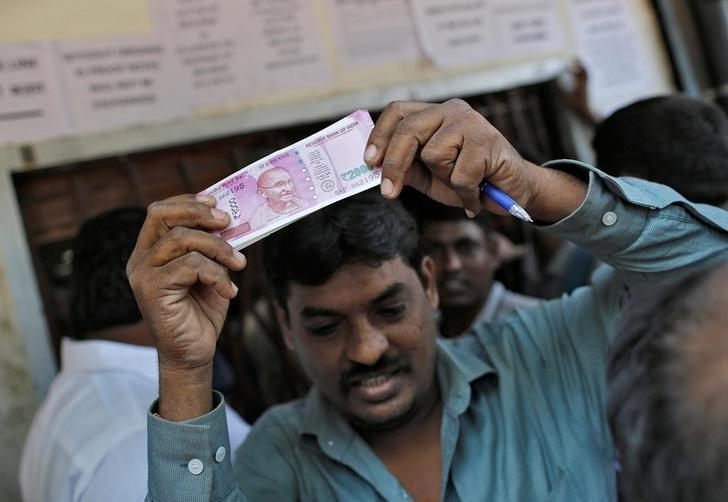 India's cash crunch seen biting into economic growth - Reuters poll