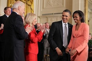President Barack Obama and first lady Michelle Obama talk with Vice President Joseph Biden and Dr. Jill Biden just after launching 