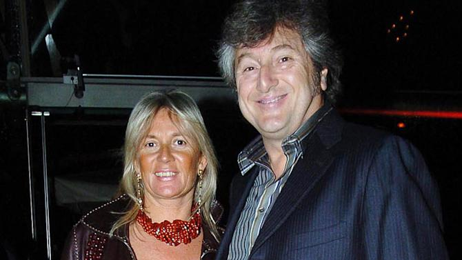 FILE - In this March 30, 2005 file photo, Vittorio Missoni, right, and his wife Maurizia Castiglioni pose for a photo in Milan, Italy. The underwater wreckage of a plane that disappeared off Venezuela on Jan. 4, 2013 with Missoni, the CEO of Italy's iconic Missoni fashion house, and five other people on board has been found, government officials and family members said Thursday, June 27, 2013. Flying with Missoni on the flight from Venezuela's Los Roques resort archipelago to Caracas, was his wife Maurizia Castiglioni, two Italian friends of the couple, and a crew of two Venezuelans. (AP Photo/Livio Valerio, Lapresse, File)