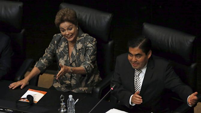 Rousseff and Barbosa gesture during a plenary session of the Mexico Senate in Mexico City