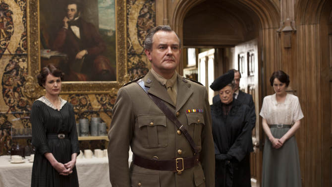"In this image released by PBS, from left, Elizabeth McGovern as Lady Cora, Hugh Bonneville as Lord Grantham, Maggie Smith as the Dowager Countess and Michelle Dockery as Lady Mary are shown in a scene from the second season of ""Downton Abbey.""  The series was nominated for a Golden Globe award on Thursday, Dec. 13, 2012. The 70th annual Golden Globe Awards will be held on Jan. 13.  (AP Photo/PBS, Carnival Film & Television Limited 2011 for MASTERPIECE, Nick Briggs)"