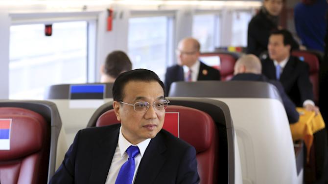 China's Premier Li sits on a CRH Harmony bullet train to Shanghai from Suzhou Railway Station, near Shanghai