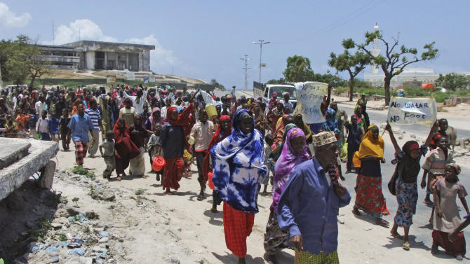 Somalis from southern Somalia demonstrate against the lack of food and water at Maka Al Mukarama road in Mogadishu, Somali, Wednesday, Sept. 14, 2011 carying placards which read 'We need food and water'. A massive aid operation is currently underway to help millions of Somalis affected by the fighting and a famine caused by severe drought. (AP Photo/Farah Abdi Warsameh)