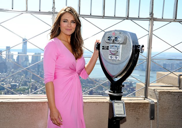 Spokesperson and model Elizabeth Hurley poses on the observation deck after lighting the Empire State Building pink in honor of the 20th Anniversary of the Estee Lauder Companies' Breast Cancer Awareness Campaign on Monday, Oct. 1, 2012 in New York. (Photo by Evan Agostini/Invision/AP)