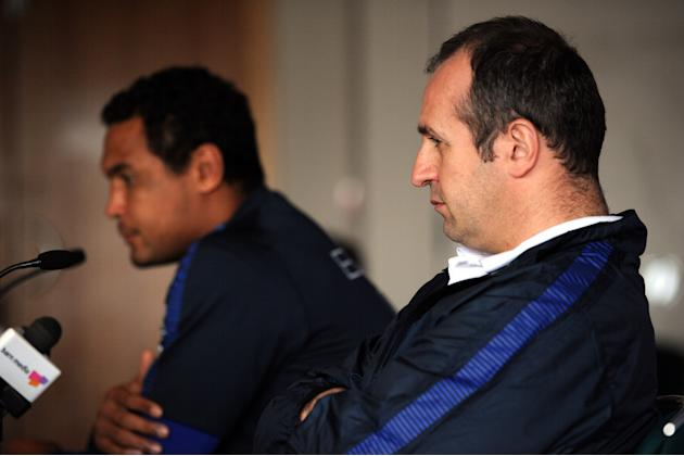 France's rugby union national team captain Thierry Dusautoir (L) and head coach Philippe Saint Andre (R) attend a press conference in Cardiff on March 16, 2012 on the eve of the rugby union 6 Nations'