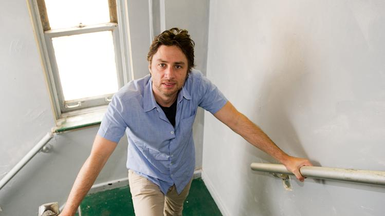 "In this June 22, 2011 photo, Zach Braff poses for a portrait in New York. Braff is set to make his debut as a playwright in the off-Broadway production ""All New People,"" opening July 25 and running through Aug. 14. (AP Photo/Charles Sykes)"
