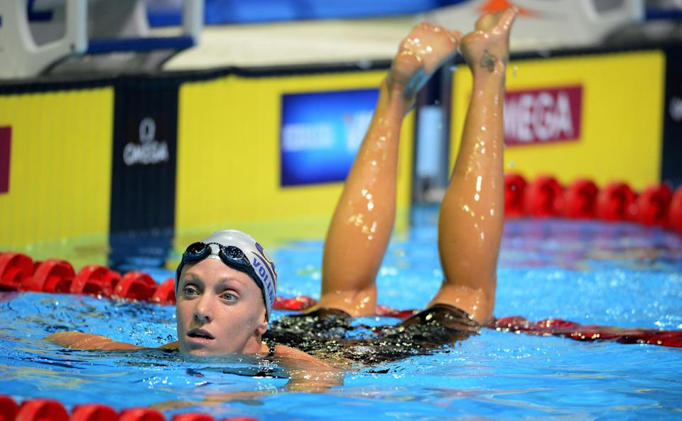 Dana Vollmer leaves her lane after swimming in the women's 200-meter freestyle preliminaries at the U.S. Olympic swimming trials, Wednesday, June 27, 2012, in Omaha, Neb. (AP Photo/Mark J. Terrill)