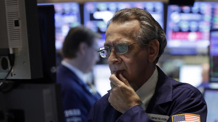 Specialist Joseph Quaglieri looks at a monitor as he works on the floor of the New York Stock Exchange, Thursday, June 20, 2013. Financial markets are sliding after the Federal Reserve said it could end its huge bond-buying program by the middle of next year. (AP Photo/Richard Drew)