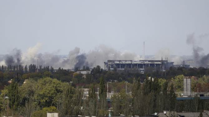 Smoke rises around the damaged main terminal of Donetsk Sergey Prokofiev International airport after recent shelling in Donetsk, eastern Ukraine