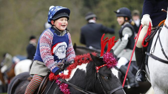 A horse wears reindeer antlers during the traditional Quorn Hunt Boxing Day meet at Prestwold Hall near Loughborough