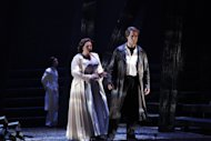 "In this undated photo provided by the Houston Grand Opera, Tamara Wilson as Elisabeth de Valois and Brandon Jovanovich as Don Carlos perform in the Houston Grand Opera's production of ""Don Carlos"" in Houston. The Houston Grand Opera is offering the original French-language version and restoring several scenes that are still rarely included. (AP Photo/Houston Grand Opera, Felix Sanchez)"