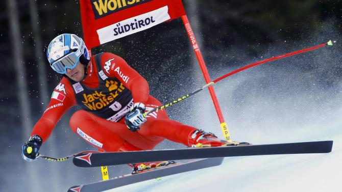 Heel of Italy clears a gate during the men's World Cup Super-G skiing race in Val Gardena