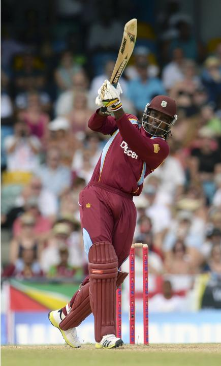 West Indies' Gayle hits a six during the first T20 international against England at Kensington Oval in Bridgetown