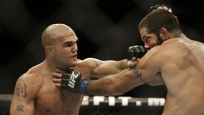 Robbie Lawler, left, punches Matt Brown during the second round of a welterweight mixed martial arts bout at a UFC event in San Jose, Calif., Saturday, July 26, 2014. Lawler won by unanimous decision