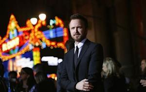 """Cast member Paul poses at the premiere of the film """"Need for Speed"""" at the TCL Chinese theatre in Hollywood"""