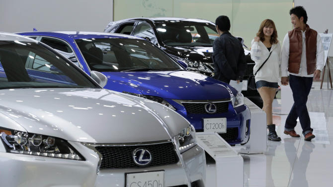 FILE - In this Nov. 5, 2012 file photo, a couple walk by Lexus models displayed at a Toyota Motor Corp. showroom in Tokyo. Now it's official: Toyota is once again the world's top automaker. Toyota released its tally for global vehicle sales for last year Monday, Jan. 28, 2013 at a record 9.748 million vehicles — a bigger number than the estimate it gave last month of about 9.7 million vehicles. (AP Photo/Koji Sasahara, File)