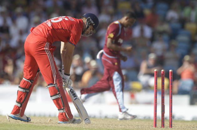 England's Alex Hales looks down after being run out by West Indies' Samuel Badree during their first T20 International cricket match at the Kensington Oval in Bridgetown, Barbados, Sunday, Mar