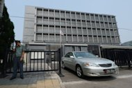 An embassy vehicle exits the Japanese embassy compound in Beijing. The new Japanese ambassador to China has been hospitalised in Tokyo, an official said, with media reporting he had collapsed unconscious