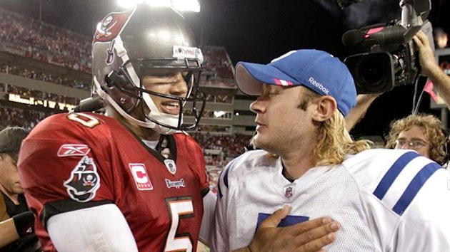 Tampa Bay Buccaneers quarterback Josh Freeman (5) talks with Indianapolis Colts quarterback Curtis Painter (7) after their NFL football game in Tampa, Florida October 3, 2011